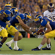 Delaware defensive lineman Ethan Clark (95) (right) grabs a West Chester fumble in the third quarter of a week 1 NCAA football game...#15 Delaware defeated West Chester 41-21 in their home opener at Delaware Stadium Thursday Aug. 30, 2012 in Newark Delaware...Delaware will return home Sept. 8, 2012 at 3:30pm for a showdown with interstate Rival Delaware State in the Route 1 Rivalry Bowl at Delaware Stadium.