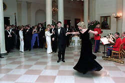 November 9, 1985 - Washington, District of Columbia, United States of America - In this photo provided by the Ronald Reagan Presidential Library Princess Diana dances with John Travolta in the Cross Hall of the White House in Washington, D.C. at a Dinner for Prince Charles and Princess Diana of the United Kingdom on November 9, 1985...Mandatory Credit: Pete Souza - Courtesy Ronald Reagan Library via CNP (Credit Image: © Pete Souza/CNP via ZUMA Wire)
