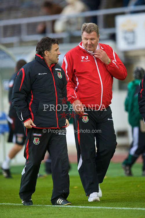 HELSINKI, FINLAND - Saturday, October 10, 2009: Wales' assistant coach Dean Saunders and manager John Toshack MBE walk off after the 2-1 defeat by Finland during the 2010 FIFA World Cup Qualifying Group 4 match at the Olympic Stadium. (Pic by David Rawcliffe/Propaganda)