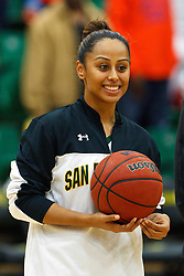 Dec 7, 2011; San Francisco CA, USA; San Francisco Lady Dons guard Rheina Ale (1) is presented with a ball commemorating her 1,000th point before the game against the Florida Gators at War Memorial Gym.  Mandatory Credit: Jason O. Watson-US PRESSWIRE
