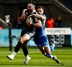 Scott Baldwin of Ospreys is tackled by Jason Tovey of Dragons<br /> <br /> Photographer Simon King/Replay Images<br /> <br /> Guinness PRO14 Round 18 - Ospreys v Dragons - Saturday 23rd March 2019 - Liberty Stadium - Swansea<br /> <br /> World Copyright © Replay Images . All rights reserved. info@replayimages.co.uk - http://replayimages.co.uk