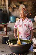 An elderly Oaxacan Zapotec cook prepares traditional food at El Sabor Zapoteco Cooking School in Teotitlan, Mexico.