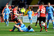 Exeter City's Troy Brown is tackled by Morecambe's Aaron McGowan during the Sky Bet League 2 match between Exeter City and Morecambe at St James' Park, Exeter, England on 30 April 2016. Photo by Graham Hunt.