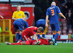 Bristol City's Jon Stead puts Bristol City's Sam Baldock in to the recovery position after a clash of heads between Elliott and Blackpool's Ian Evatt - Photo mandatory by-line: Joe Meredith/JMP  - Tel: Mobile:07966 386802 17/11/2012 - Bristol City v Blackpool - SPORT - FOOTBALL - Championship -  Bristol  - Ashton Gate Stadium -
