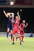 York City midfielder, on loan from Oxford United, Michael Collins challenges Doncaster Rovers forward Andy Williams  during the Johnstone's Paint Trophy match between York City and Doncaster Rovers at Bootham Crescent, York, England on 6 October 2015. Photo by Simon Davies.