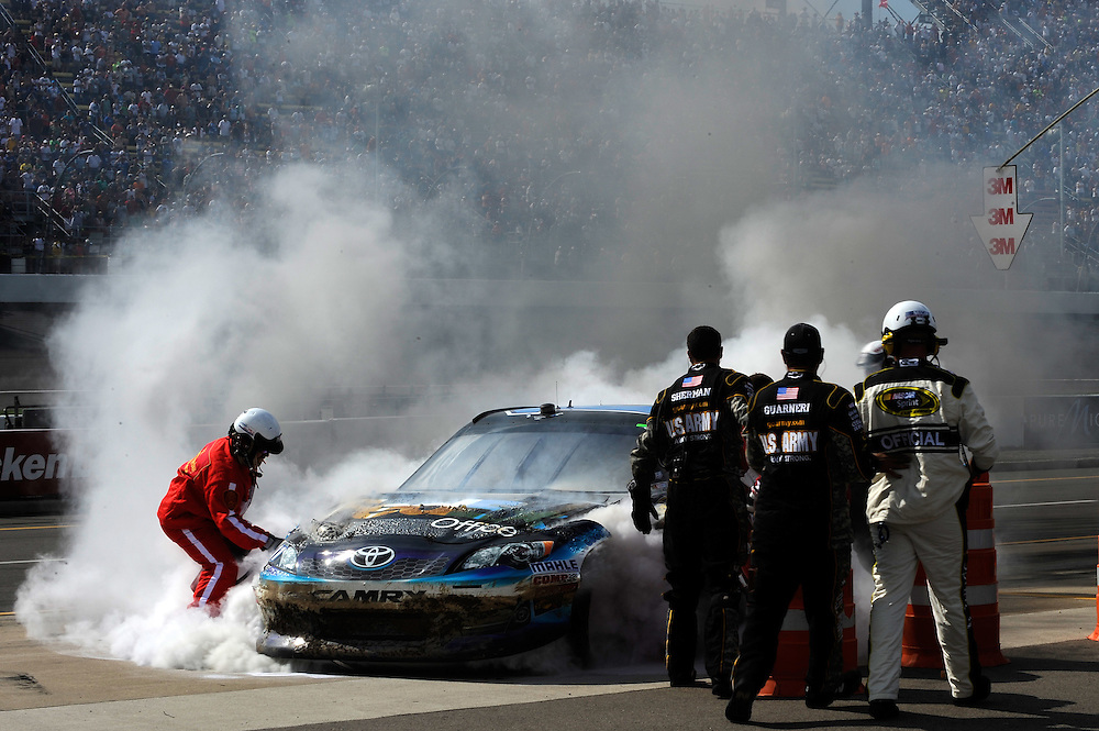 15-17 June, 2012, Brooklyn, Michigan USA.Fire crew, Denny Hamlin, FedEx Office Toyota Camry .(c)2012, Scott R LePage .LAT Photo USA