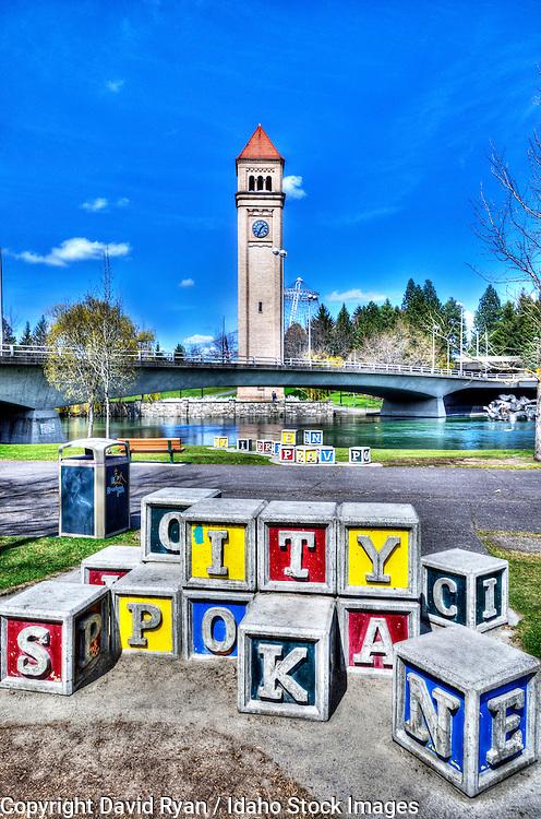 Giant blocks in River Front Park, Spokane, Washington, Spokane River and the Clock Tower in background