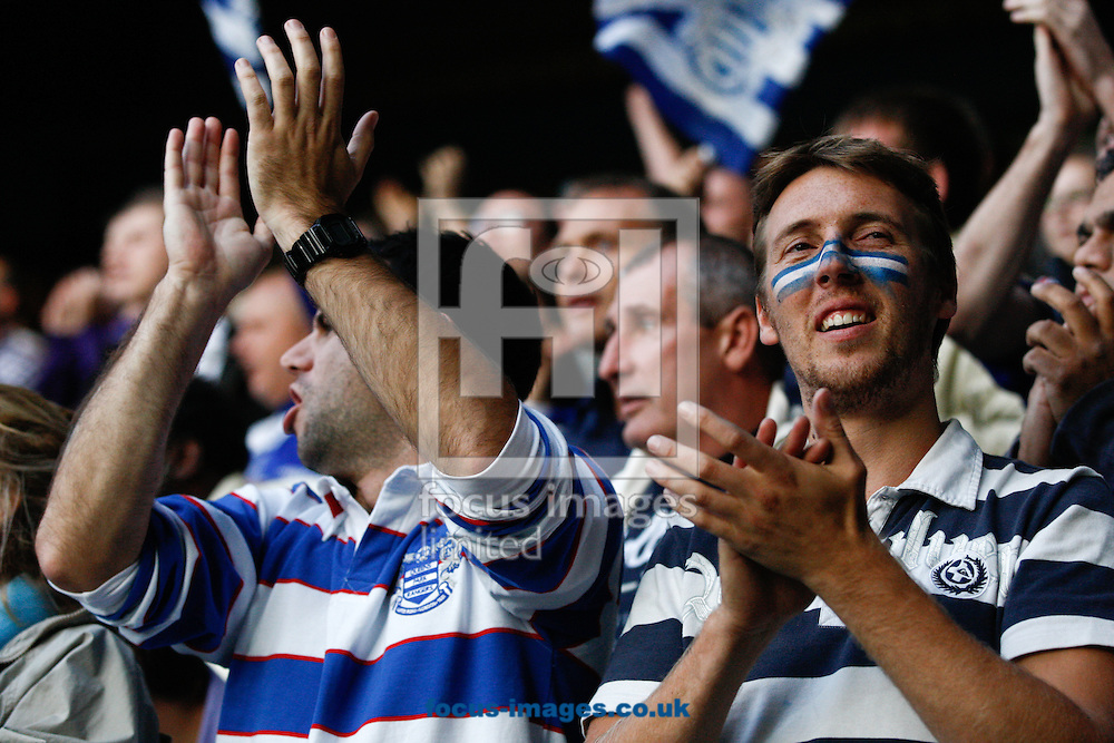 Picture by Andrew Tobin/Focus Images Ltd. 07710 761829. 23/10/11. QPR suporters celebrates as their team beat Chelsea 1-0 during the Barclays Premier League match between QPR and Chelsea at Loftus Road, London.