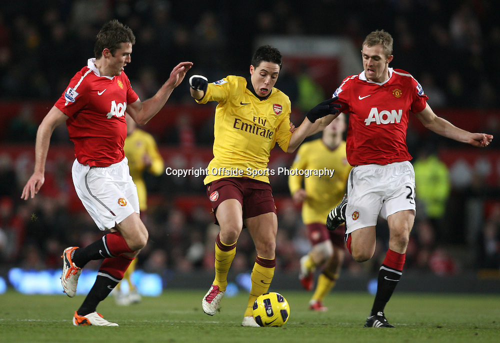 13/12/2010 - Barclays Premier League - Manchester United vs. Arsenal - Michael Carrick of Man Utd (L) and Darren Fletcher of Man Utd (R) battle with Samir Nasri of Arsenal - Photo: Simon Stacpoole / Offside.