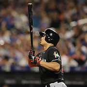 NEW YORK, NEW YORK - July 05: Giancarlo Stanton #27 of the Miami Marlins hits a three run homer in the eighth inning during the Miami Marlins Vs New York Mets regular season MLB game at Citi Field on July 05, 2016 in New York City. (Photo by Tim Clayton/Corbis via Getty Images)