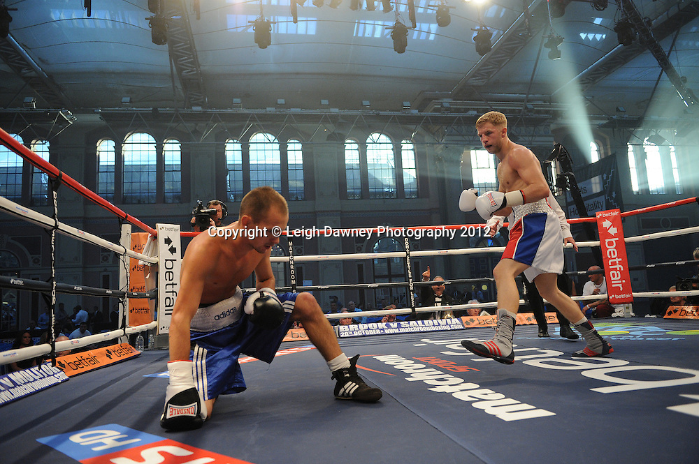 Ryan Taylor (white/red shorts) defeats Gyula Vajda in a 6x3 Lightweight contest at Alexandra Palace, Muswell Hill, North London on Saturday 8th September 2012. Matchroom Sport. Pictures © Leigh Dawney Photography 2012.
