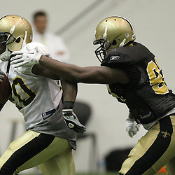 August 5, 2011; Metairie, LA, USA; New Orleans Saints running back Joique Bell (20) runs past defensive end Junior Galette (93) during training camp practice at the New Orleans Saints practice facility. Mandatory Credit: Derick E. Hingle