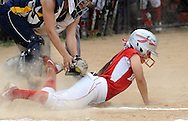 FAIRLESS HILLS, PA - MAY 27:  Morrisville's catcher Delila Mena applies a late tag on Bristol's Katelyn Santana as she slides into home plate during a District One Class A softball semifinal game May 27, 2014 in Fairless Hills, Pennsylvania. Bristol defatted Morrisville 10-0 in five innings. (Photo by William Thomas Cain/Cain Images)