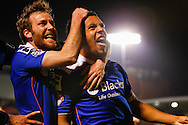 Korey Smith of Oldham Athletic (right) celebrates scoring his team's first goal to make it 1-1 with James Dayton of Oldham Athletic (left) during the Sky Bet League 1 match at the Matchroom Stadium, London<br /> Picture by David Horn/Focus Images Ltd +44 7545 970036<br /> 25/03/2014