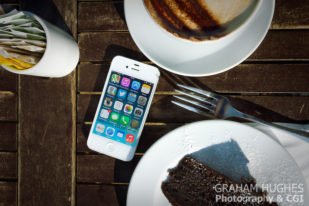 iPhone 4s On Table With Cake And Cappuccino