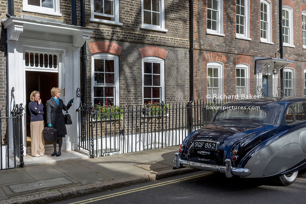 A 1964 Empress Bentley is parked in Smith Square, a small square behind the Houses of Parliament, before collecting their VIP passengers - barristers who are being sworn in as QCs (aka Silks in legal vernacular), on 11th March 2019, in London, England.