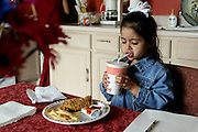 (MODEL RELEASED IMAGE). The day following the Fernandez children's soccer game, it's back to less less-than-traditional fare: takeout chicken and soda pop. Hungry Planet: What the World Eats (p. 273). The Fernandez family of San Antonio, Texas, is one of the thirty families featured, with a weeks' worth of food, in the book Hungry Planet: What the World Eats.