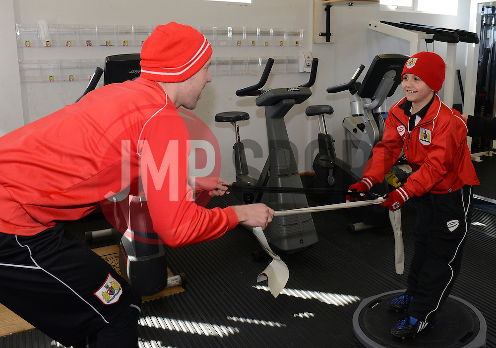 Bristol City's Scott Wagstaff warms up with Connor in the Gym - Photo mandatory by-line: Dougie Allward/JMP - Mobile: 07966 386802 - 01/04/2015 - SPORT - Football - Bristol - Bristol City Training Ground - HR Owen and SAM FM