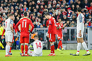 Liverpool midfielder Jordan Henderson (14) injured, on the ground, during the Champions League match between Bayern Munich and Liverpool at the Allianz Arena, Munich, Germany, on 13 March 2019.