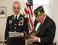 Lt. Col. Roy Hunter presents Pvt 1st Class Rosario Cadorette with two Bronze Stars and a Purple Heart medal for his service to our country in World War II at a presentation in his honor with the American Legion Post at the Belmont Mill on Wednesday afternoon.  (Karen Bobotas/for the Laconia Daily Sun)