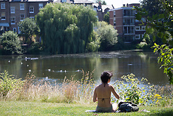 © licensed to London News Pictures. London, UK 01/08/2013. People sunbathing at Hampstead Heath Park in north London on Thursday, August 1, 2013. Photo credit: Tolga Akmen/LNP