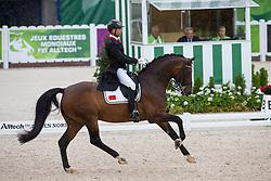 Yessin Rahmouni, (MAR), Floresco NRW - Grand Prix Team Competition Dressage - Alltech FEI World Equestrian Games™ 2014 - Normandy, France.<br /> © Hippo Foto Team - Leanjo de Koster<br /> 25/06/14