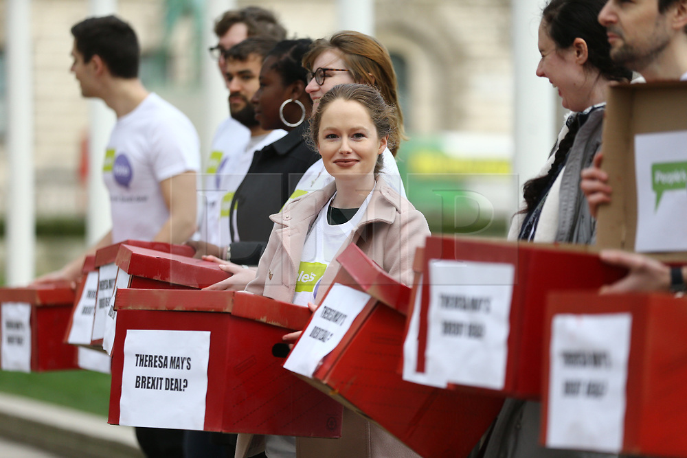 """© Licensed to London News Pictures. 14/01/2019. London UK. Activists from the People's Vote campaign are in Parliament Square this morning unveiling 'Deal or No Deal' boxes. On the outside, the boxes say """"Theresa May's Brexit deal?"""", and on the inside they say """"People's Vote"""".Photo credit: Andrew McCaren/LNP"""