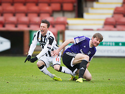 Dunfermline&rsquo;s Joe Cardle tackled by Ayr United&rsquo;s Jamie Adams. <br /> Dunfermline 3 v 2 Ayr United, Scottish League One played at East End Park, 13/2/2016.
