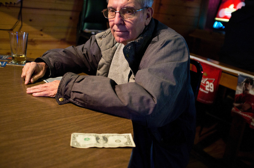 A man plays cribbage at a bar on Wednesday, November 30, 2011 in Webster City, IA.