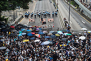 Protesters occupy roads in front of the Central Government Offices, during a protest against a proposed extradition law in Hong Kong, SAR China, on Wednesday, June 12, 2019. Hong Kong's legislative chief postponed the debate on legislation that would allow extraditions to China after thousands of protesters converged outside the chamber demanding the government to withdraw the bill. Photo by Suzanne Lee/PANOS