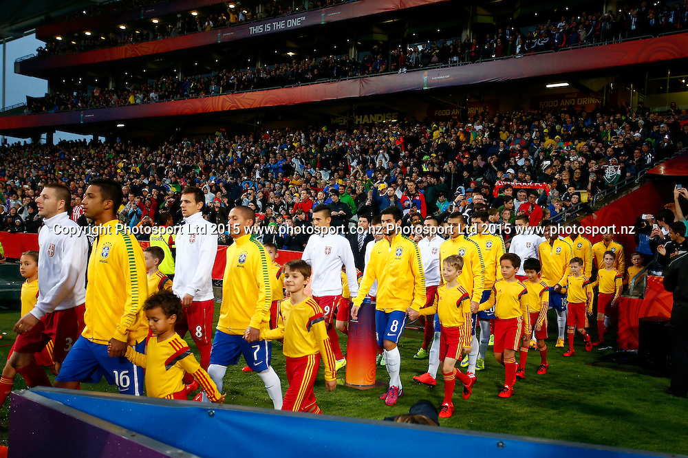 The teams come out to the field during the FIFA U20 World Cup Final, Serbia v Brazil, QBE Stadium, Auckland, Saturday 20th June 2015. Copyright Photo: Shane Wenzlick / www.photosport.nz