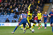 Sunderland defender Tom Flanagan (12) battles for possession  with Oxford United forward Dan Agyei (23) during the EFL Sky Bet League 1 match between Oxford United and Sunderland at the Kassam Stadium, Oxford, England on 15 February 2020.