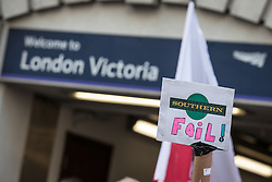 © Licensed to London News Pictures. 10/08/2016. London, UK. Commuters protest for 'fairer fares' in Victoria Station, London. Southern Rail staff have called off the final two days of a week-long strike over job losses and passenger safety. Photo credit: Rob Pinney/LNP