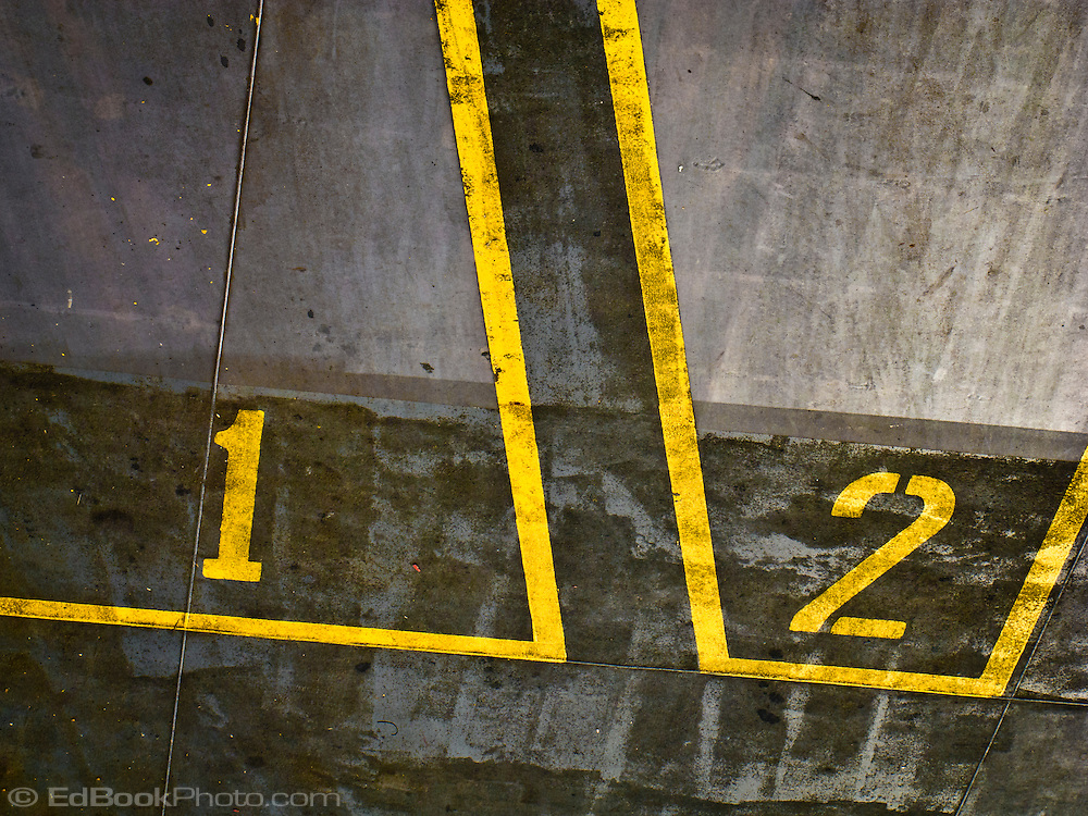 an abstract of the parking lanes viewed from above showing lanes and numerals 1 and 2 in yellow aboard a Washington state ferry in Puget Sound, WA, USA