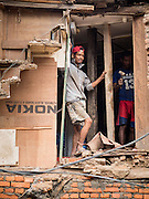 06 AUGUST 2015 - KATHMANDU, NEPAL: Men rebuild a house near Seto Machindranath Temple in Kathmandu. The home was one of thousands in the area damaged in the Nepal Earthquake. The Nepal Earthquake on April 25, 2015, (also known as the Gorkha earthquake) killed more than 9,000 people and injured more than 23,000. It had a magnitude of 7.8. The epicenter was east of the district of Lamjung, and its hypocenter was at a depth of approximately 15 km (9.3 mi). It was the worst natural disaster to strike Nepal since the 1934 Nepal–Bihar earthquake. The earthquake triggered an avalanche on Mount Everest, killing at least 19. The earthquake also set off an avalanche in the Langtang valley, where 250 people were reported missing. Hundreds of thousands of people were made homeless with entire villages flattened across many districts of the country. Centuries-old buildings were destroyed at UNESCO World Heritage sites in the Kathmandu Valley, including some at the Kathmandu Durbar Square, the Patan Durbar Squar, the Bhaktapur Durbar Square, the Changu Narayan Temple and the Swayambhunath Stupa. Geophysicists and other experts had warned for decades that Nepal was vulnerable to a deadly earthquake, particularly because of its geology, urbanization, and architecture.     PHOTO BY JACK KURTZ