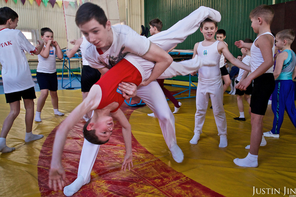 Children perform gymnastics in the town of Slavutych, which has some of the highest birth rates in Ukraine. <br /> <br /> Slavutych rises out of the ashes of the Chernobyl nuclear disaster in April 26, 1986. People living near the disaster area were largely moved to the new city, built from scratch for the sole purpose of housing the population displaced by the nuclear accident.