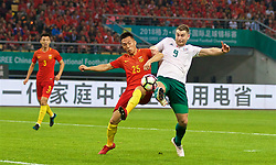 NANNING, CHINA - Thursday, March 22, 2018: Wales' Sam Vokes scores the third goal during the opening match of the 2018 Gree China Cup International Football Championship between China and Wales at the Guangxi Sports Centre. (Pic by David Rawcliffe/Propaganda)