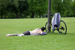 © Licensed to London News Pictures. 02/05/2020. London, UK. A man sunbathing in Finsbury Park, north London during the lockdown over the spread of COVID-19. The government has ordered that people go out for one form of exercise a day, shopping for basic necessities, any medical need, to provide care or to help a vulnerable person and travel to and from work and to keep 2 meters away from other people at all times to slow the spread of the coronavirus and reduce pressure on the NHS. Photo credit: Dinendra Haria/LNP