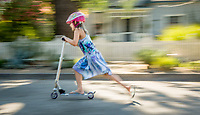 On the final week of summer break, Mya Shuler speeds through the streets of Calistoga on her Razor push scooter.