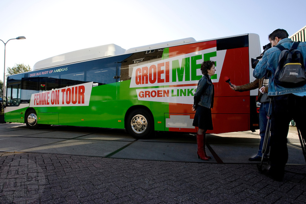 GroenLinks lijsttrekker Femke Halsema beantwoordt bij de camapgenbus vragen van de regionale pers tijdens de start van de verkiezingscampagne. <br /> <br /> GroenLinks party leader Femke Halsema is being interviewed by the press at the start of the campaign.