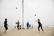 Kerri Walsh Jennings, right, gets in an early morning practice with her new partner Nicole Branagh, left, on Manhattan Beach. Walsh warms up with assistant coach Gustavo Rocha, while Branagh warms up with head coach Marcio Sicoli.