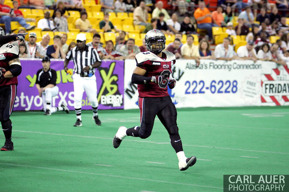 6-28-2007: Anchorage, AK - Thomas Ford Jr. lines up in the Alaska Wild 47 to 53 loss to the CenTex Barracudas at the Sullivan Arena.....