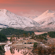 Glen Affric on a crisp November morning from the classic viewpoint between Loch Beinn a'Mheadhoin and Loch Affric. I was still half asleep and was quickly losing the feeling in my fingers, but well worth the wait for the sunrise to bathe the distant snow with a wonderful pink light.