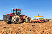 Case 485HD tractor and plough in ploughed field