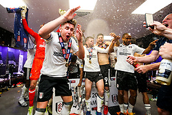 Free to use courtesy of Sky Bet. Goalscorer Tom Cairney and his teammates spray champagne as Fulham celebrate in the dressing room after winning the game 0-1 to win the Sky Bet Championship Play-Off Final and secure Promotion to the Premier League - Rogan/JMP - 26/05/2018 - FOOTBALL - Wembley Stadium - London, England - Aston Villa v Fulham - Sky Bet Championship Play-Off Final.