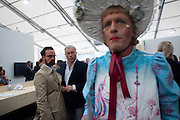 ALEXANDER LEBEDEV; EVEGENY LEBEDEV; GRAYSON PERRY, Opening of Frieze 2009. Regent's Park. London. 14 October 2009 *** Local Caption *** -DO NOT ARCHIVE-© Copyright Photograph by Dafydd Jones. 248 Clapham Rd. London SW9 0PZ. Tel 0207 820 0771. www.dafjones.com.<br /> ALEXANDER LEBEDEV; EVEGENY LEBEDEV; GRAYSON PERRY, Opening of Frieze 2009. Regent's Park. London. 14 October 2009