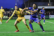 Lyle Taylor of AFC Wimbledon stands up against Daniel Leadbitter of Bristol Rovers during the Sky Bet League 2 match between AFC Wimbledon and Bristol Rovers at the Cherry Red Records Stadium, Kingston, England on 26 December 2015. Photo by Stuart Butcher.