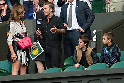LONDON, ENGLAND - Wednesday, July 6, 2016: Mirka Federer chatting to David Beckham after her husband Roger Federer won the Gentlemen's Single Quarter Finals match on day ten - of the Wimbledon Lawn Tennis Championships at the All England Lawn Tennis and Croquet Club. (Pic by Kirsten Holst/Propaganda)