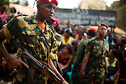 "Soldiers stand guard during the visit of Guinea's president Captain Moussa Dadis Camara at the Kofi Annan private university in Conakry, Guinea on Thursday March 5, 2009. Camara, who took power after a coup in December 2008, was visiting the university to ""meet the youth"", as part of his efforts to solidify his support from Guinea's population.(Olivier Asselin for the New York Times)"