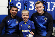 AFC Wimbledon striker Joe Pigott (39), AFC Wimbledon striker Kweshi Appiah (9) and mascot during the EFL Sky Bet League 1 match between AFC Wimbledon and Southend United at the Cherry Red Records Stadium, Kingston, England on 24 November 2018.
